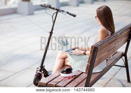 Involved in virtual world. Positive pleasant beautiful woman using laptop and resting while using laptop