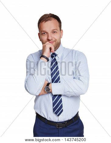 Young pensive businessman isolated on white. Portrait of a confident thoughtful guy in trendy blue shirt and striped tie looking at camera and smiling