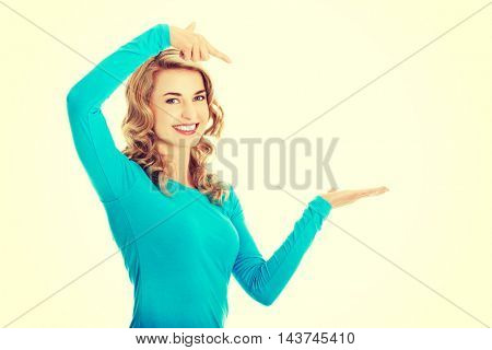Woman showing something or copyspase