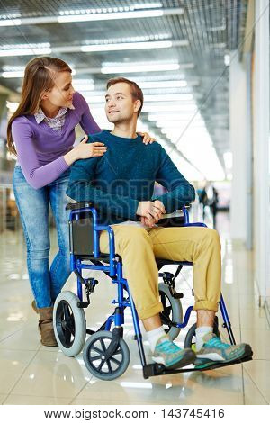 Loving Woman Supporting Handicapped Husband