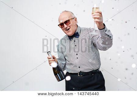 Senior Man Celebrating with Sparkling Wine