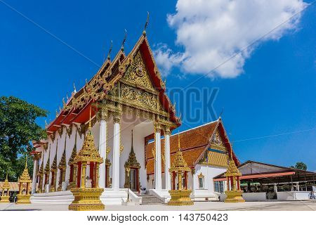 Thai Church On the clear sky day. Thailand architecture. Buddhist dignitaries at the place.