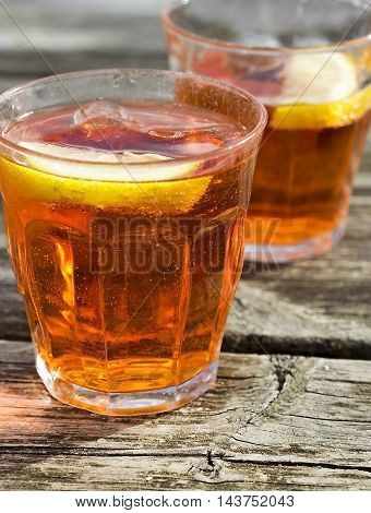 Two refreshing glasses of Spritz on wood