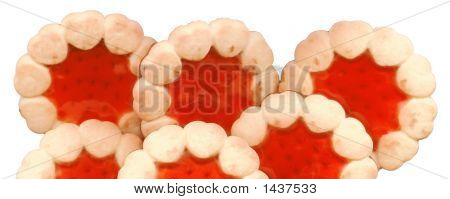 Round cookies; object on cleanly white background; beautiful and very tasty cookies with red jelly poster