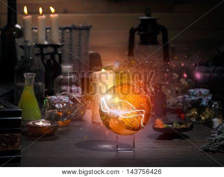 Golden Sphere. Magic items. Flasks retort for alchemy. Beautiful glow. Concept - the magician mystic paranormal phenomena. Occult esoteric spiritualism calling the spirits and ghosts