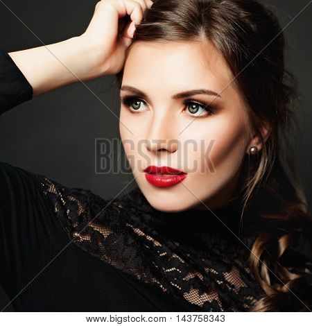 Cute Girl. Beautiful Makeup and Hairstyle. Face Closeup