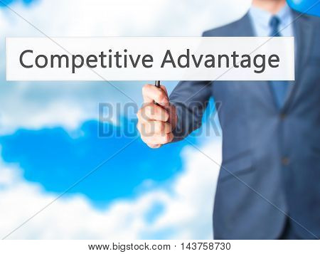 Competitive Advantage - Business Man Showing Sign