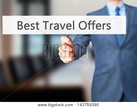 Best Travel Offers - Hand Pressing A Button On Blurred Background Concept On Visual Screen.
