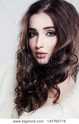 Pretty Female Face with dark hair. Curly and Makeup