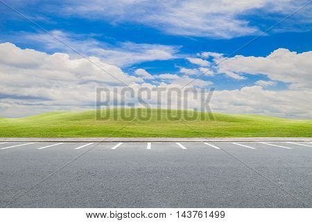 parking lot parking lane outdoor with green grass and beautiful blue sky background
