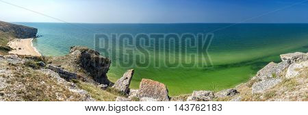 panorama of the sea coast with rocks and sand beach