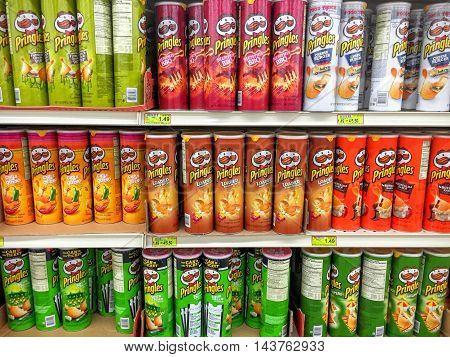 Spencer Wisconsin - August 23 2016 Several cans of Prigles brand potato chips on a modern grocery shelf