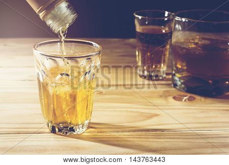 Pour alcohol placed on a wooden background.