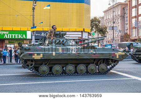 Kiev Ukraine - August 22 2016: Rehearsals for military parade for Independence Day on Khreshchatyk in Kiev Ukraine. Ukrainian soldier on an armored personnel carrier (APC).