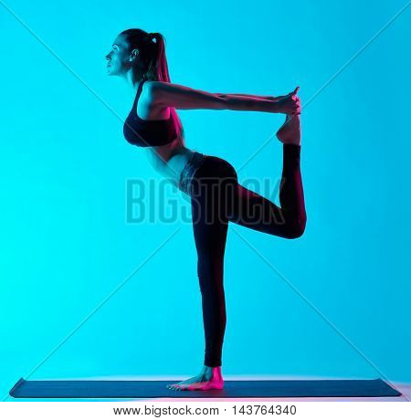 woman yoga exercices Natarajasana dancer pose