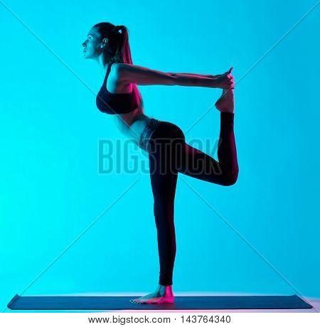 woman yoga exercices Natarajasana dancer pose
