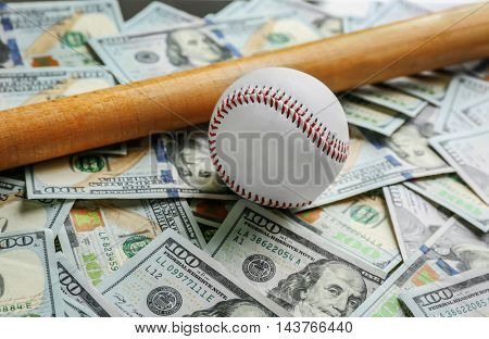 Baseball and bat on dollars background. Corruption concept