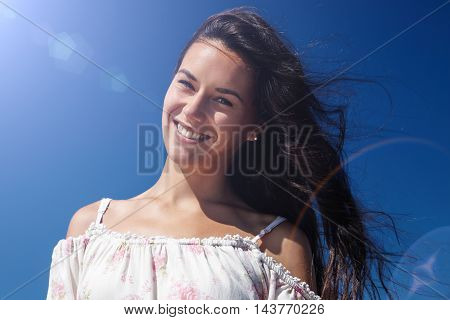happy smiling portrait of woman with sunny flair
