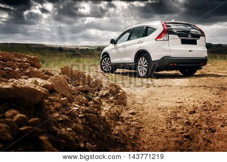 Saratov, Russia - August 28, 2014: Car Honda Cr-v Stand At Countryside Road Near Forest At Daytime