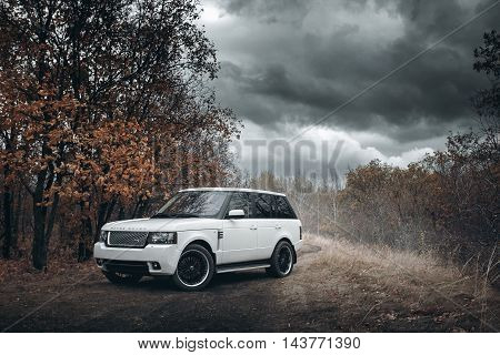 Saratov, Russia - October 11, 2015: White Car Land Rover Range Rover Stand On Countyiside Off-road A