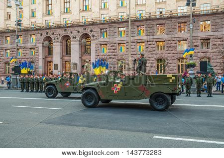 Kiev Ukraine - August 22 2016: Rehearsals for military parade for Independence Day in Kiev Ukraine. Military cars in the background of the Kyiv City Hall.
