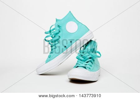 Turquoise sneakers on blank white background