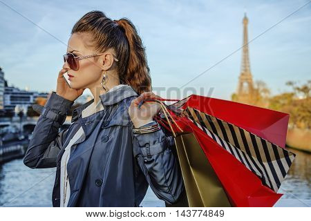 Elegant Woman With Shopping Bags Speaking On Mobile Phone, Paris