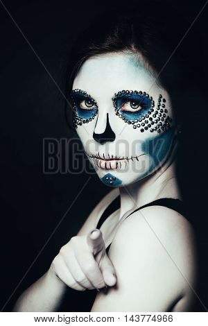 Woman with Halloween Makeup. Sugar skull Beautiful Model. Santa Muerte concept.