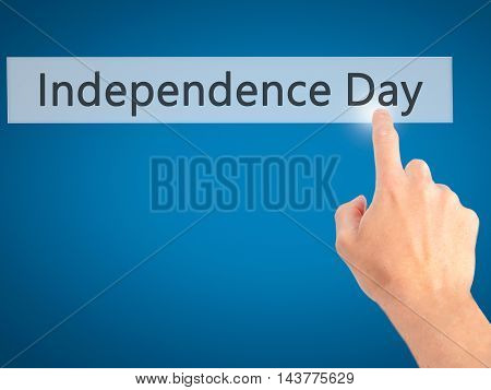 Independence Day - Hand Pressing A Button On Blurred Background Concept On Visual Screen.