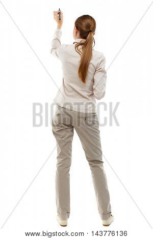 back view of writing beautiful woman. Rear view people collection.  backside view of person. Isolated over white background. Skinny girl in white denim suit is writing on the blackboard.
