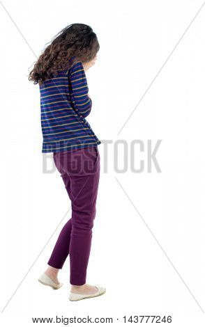 back view of walking  woman. beautiful girl in motion.  backside view of person.  Rear view people collection. Isolated over white background. Long-haired curly girl in a blue jacket crying