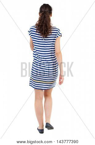 back view of walking  curly woman.  backside view of person.  Rear view people collection. Isolated over white background. Swarthy girl in a checkered dress walks forward.