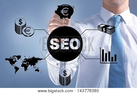 Businessman push button on virtual screen. SEO technology
