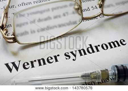 Paper with words Werner syndrome and glasses. Medical concept.