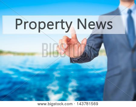 Property News -  Businessman Press On Digital Screen.