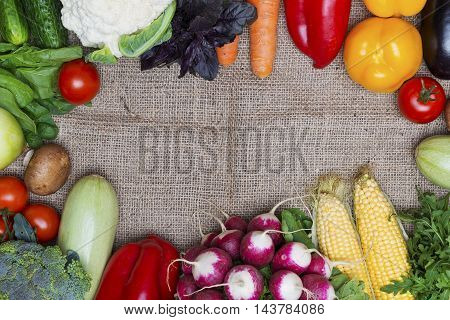 Fresh vegetables on rustic fabric background with copy-space