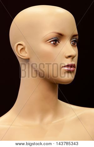 Face of girl mannequin isolated on black background