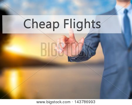 Cheap Flights -  Businessman Press On Digital Screen.