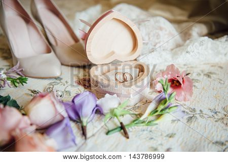 close up by bridal wedding accessories on dressing table.