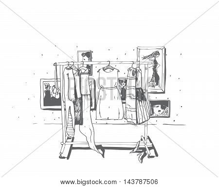 Black and white fashion illustration with hand drawn hangers with dresses. Interior with frames shoes. Vector sketch illustration dresses set summer clothes outerwear for women isolated on white.