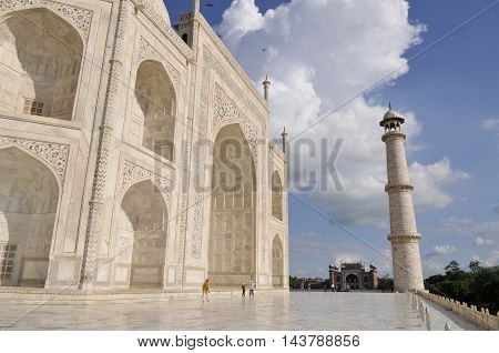 AGRA, INDIA - AUG 9 2010: A side view of the world famous Taj Mahal, showing the intricate details of the marble. Also in view are one of its minarets.