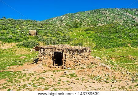 The ramshackle shed built of stone and clay located on the foothill of Samak kishlak (village) Uzbekistan. poster
