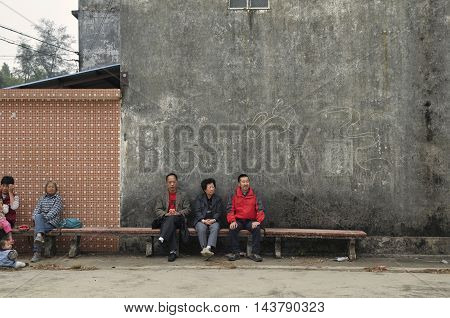 TAISHAN, GUANGDONG, CHINA - Dec 2 2014: Residents and visitors mingle in a rural village.