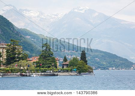 Menaggio Italy - May 06 2016: Some people are walking on embankment of the town view from Lake Como