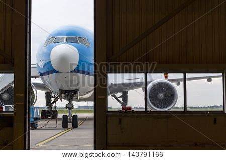 Airplane In Front Of Hangar