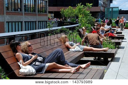 New York City - July 3 2009: Wooden benches offer a chance to relax and chill out at the elevated High Line Park in the West Village