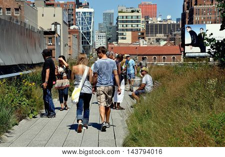 New York City - August 27 2010: Strollers walking along Section 1 of the popular High Line Park built atop a 1930's elevated freight train line