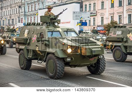 Kiev Ukraine - August 22 2016: Military parade rehearsal for 25 years of Ukraine's independence in Kyiv Ukraine. Ukrainian soldier on an armored personnel carrier (APC).