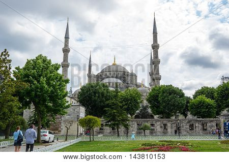 ISTANBUL TURKEY - JUNE 19 2015: Sultan Ahmet Mosque (Turkish: Sultan Ahmet Camii) is a historic mosque in Istanbul Turkey. The mosque is popularly known as the Blue Mosque for the blue tiles adorning the walls of its interior