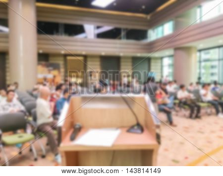Motion blur of view of seminar with audience in a seminar room background in coffee break time
